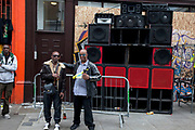Sound system at Notting Hill Carnival in West London. The Notting Hill Carnival is an annual event which since 1964 has taken place each August, over two days (the August bank holiday Monday and the day beforehand). It is led by members of the West Indian / Caribbrean community, particularly the Trinidadian and Tobagonian British population, many of whom have lived in the area since the 1950s. The carnival has attracted up to 2 million people in the past, making it the second largest street festival in the world. The celebration centres around a parade of floats, dancers and sound systems.