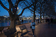 People walking along the riverside walkway as dusk turns to evening on the Southbank, London, United Kingdom. The South Bank is a significant arts and entertainment district, and home to an endless list of activities for Londoners, visitors and tourists alike. (photo by Mike Kemp/In Pictures via Getty Images)