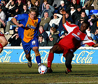 Photo: Dave Linney.<br />Shrewsbury Town v Leyton Orient. Coca Cola League 2. 04/03/2006Shrewsbury's .Dave Edwards(L) holds off the challenge from   Gabriel Zakuani