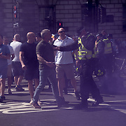 Police excort a few British Nationalists cross near the anti-fascist line and been chased away  on 6 May 2018, London, UK