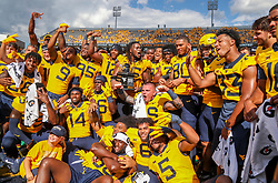 Sep 18, 2021; Morgantown, West Virginia, USA; West Virginia Mountaineers players pose with the Black Diamond Trophy after defeating the Virginia Tech Hokies at Mountaineer Field at Milan Puskar Stadium. Mandatory Credit: Ben Queen-USA TODAY Sports