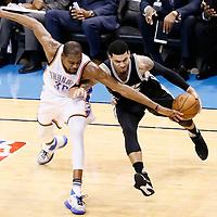 08 May 2016: San Antonio Spurs guard Danny Green (14) drives past Oklahoma City Thunder forward Kevin Durant (35) during the Oklahoma City Thunder 111-97 victory over the San Antonio Spurs, during Game Four of the Western Conference Semifinals of the NBA Playoffs at the Chesapeake Energy Arena, Oklahoma City, Oklahoma, USA.