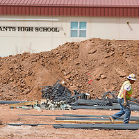 032213       Brian Leddy<br /> A construction worker prepares rebar for the foundation of a new performing arts center at Grants High School Friday. The project is one of several public works projects being worked on in Grants.