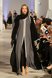 © Licensed to London News Pictures. 19/02/2017. London, UK.  A model presents a look by Abaya Buth (London) on the final day of the UK's first London Modest Fashion Week taking place this weekend at the Saatchi Gallery.  The two day event sees 40 brands from across the world come together to showcase their collections for Muslim and other religious women. Photo credit : Stephen Chung/LNP