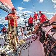 Leg 8 from Itajai to Newport, day 04 on board MAPFRE, Xabi Fernandez tiding a rope after a peeling. 25 April, 2018.