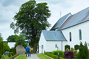 Visitors at Jelling Church and UNESCO Jelling Stones runestones, birthplace of Christianity in Denmark