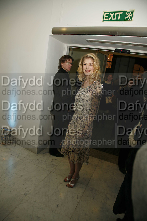 """ROSAMUND PIKE, Party given by  Peroni  beer to announce the launch of it's remake of the classic 1960's film """"La Dolce Vita"""". The Design Museum, Shad thamesm 6 April 2006. ONE TIME USE ONLY - DO NOT ARCHIVE  © Copyright Photograph by Dafydd Jones 66 Stockwell Park Rd. London SW9 0DA Tel 020 7733 0108 www.dafjones.com"""