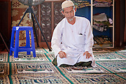 """Sept. 24, 2009 -- PATTANI, THAILAND: Muslim men pray at Krue Se Mosque in Pattani, Thailand. The Krue Se Mosque is one of Thailand's most historic mosques and long a flash point in Muslim - Buddhist confrontation. The mosque was first destroyed by advancing Thais when Pattani was an independent kingdom in 1786. It was restored in the 1980's but heavily damaged by rockets fired by unknown assailants in 2005. It has since been partially restored by local Muslims and the Thai government. Thailand's three southern most provinces; Yala, Pattani and Narathiwat are often called """"restive"""" and a decades long Muslim insurgency has gained traction recently and nearly 4,000 people have been killed since 2004. The three southern provinces are under emergency control and there are more than 60,000 Thai military, police and paramilitary militia forces trying to keep the peace battling insurgents who favor car bombs and assassination.    Photo by Jack Kurtz / ZUMA Press"""