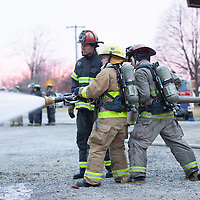 Candidate Firefighters train to put out a propane fire