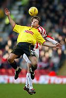 Photo: Scott Heavey.<br />Watford v Sunderland. Nationwide Division One. 07/02/2004.<br />Scott Fitzgerald holds the ball from George McCartney