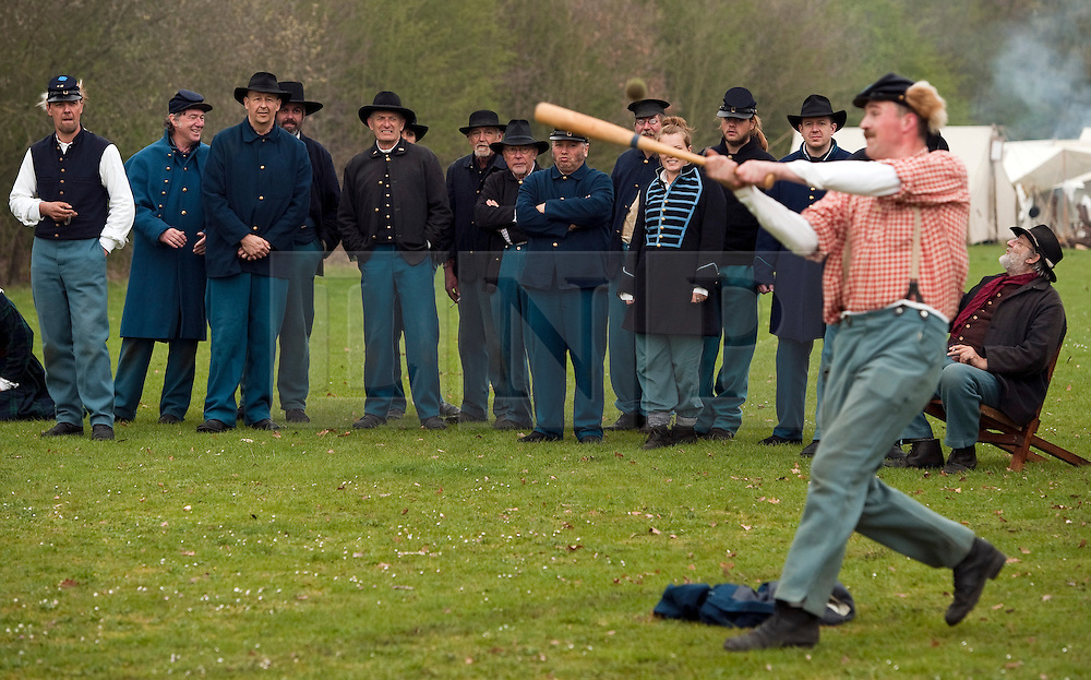 © London News Pictures. 08/04/2012. South Okendon, UK.  Members of the Southern Skirmish Association playing baseball before taking part in a reenactment of the final days of the American Cival war at Belhus Wood Country Park near South Okenden, Essex on April 8, 2012. Baseball was invented during the American Civil war which ended on April 9 (tomorrow), 1865 when the  Confederate surrendered to the Union. Photo credit :  Ben Cawthra/LNP
