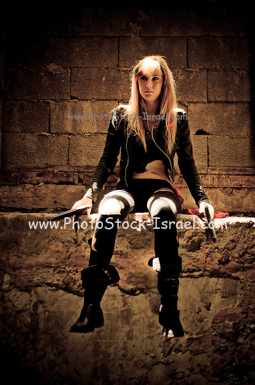 Aggressive Young woman in her 20s with hand gun