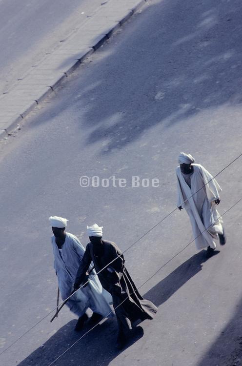3 traditional Muslim men walking