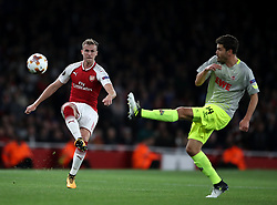 FC Koln's Jonas Hector (right) and Arsenal's Rob Holding battle for the ball during the Europa League match at the Emirates Stadium, London.