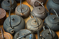 Traditional Japanese tea kettles. Though Toji Temple dates from the 7th century, it comes to life once a month on the 21st during its lively flea market. Though often called Toji Antique Market, in fact goods of all descriptions, including food, are in abundance here.