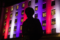 London, UK. 31 January, 2020. The statue of Viscount Montgomery stands in front of the Ministry of Defence building illuminated in red, white and blue on the evening of Brexit Day shortly before the UK leaves the European Union.