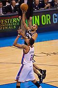 June 2, 2012; Oklahoma City, OK, USA; San Antonio Spurs guard Tony Parker (9) takes a shot over Oklahoma City Thunder guard Thabo Sefolosha (2) during the first half of a playoff game at Chesapeake Energy Arena.  Mandatory Credit: Beth Hall-US PRESSWIRE