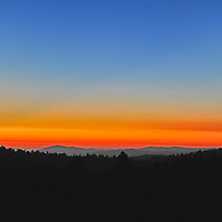 A sunset glows over the western foothills of California's Sierra Nevada.