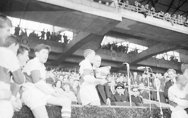 Derry captain accepting the Sam Maguire cup after their win in the All Ireland Minor Gaelic Football Final Kerry v. Derry in Croke Park on the 26th September 1965.
