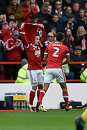 """Nottingham Forest midfielder Barrie McKay (10) celebrates scoring a goal, making the score 1-0, and holds up a shirt with """"Dylan"""" on the back, during the EFL Sky Bet Championship match between Nottingham Forest and Burton Albion at the City Ground, Nottingham, England on 21 October 2017. Photo by Richard Holmes."""