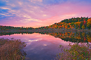 Autumn  colors at dawn reflected in Lac Boyer in the Laurentian Mountains. Great Lakes - St.  Lawrence Forest Region.<br />La Mauricie National Park<br />Quebec<br />Canada