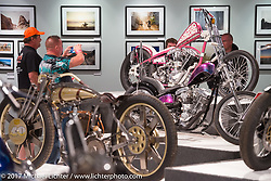 Checking out Nick Pensabene's custom Shovelhead in the Old Iron - Young Blood exhibition in the Motorcycles as Art gallery at the Buffalo Chip during the annual Sturgis Black Hills Motorcycle Rally. Sturgis, SD, USA. Wednesday August 9, 2017. Photography ©2017 Michael Lichter.