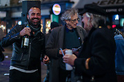 Piers Corbyn attends a night-out with people drinking outside a bar in Soho, London on Friday, Oct 9, 2020 -  after the 10 pm curfew. Pubs and restaurants are subject to in order to curb the spread of coronavirus. Boris Johnson is to outline a new three-tiered system of coronavirus restrictions on Monday that is expected to cause pubs and restaurants to shut across the north of England. (VXP Photo/ Vudi Xhymshiti)