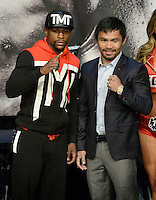 April 29.2015. Las Vegas NV.  Floyd Mayweather Jr.(L) poses with Manny Pacquiao at the final press conference at the MGM grand hotel Wednesday. The two will be fighting this Saturday May 2nd at the MGM grand hotel in Las Vegas. Photo by Gene Blevins/LA DailyNews