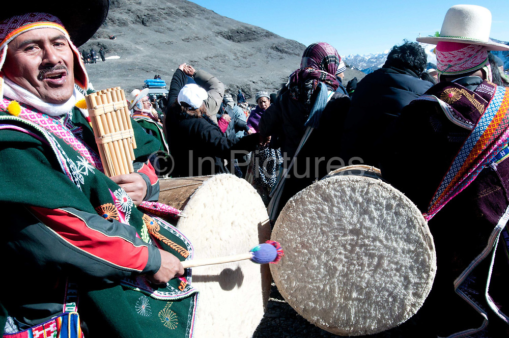 Bolivia,  June 2013. La Cumbre , near La Paz, 15,260 feet, 4,650 metres . 21st June Aymara New Year (Machaq Mara) , the winter solstice when the sun  comes to earth and signifies the time for planting and new growth. Musicians play to welcome the New year.