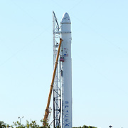 Workers review the SpaceX Falcon 9 rocket at Cape Canaveral's Complex 40 launch pad after cracks were discovered on a nozzle on December 6, 2010 at Cape Canaveral, Florida. (AP Photo/Alex Menendez)