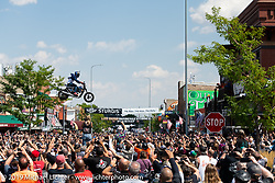 Motorcycle stunt-man Cole Freeman jumps Main Street during the Sturgis Motorcycle Rally. SD, USA. Saturday, August 14, 2021. Photography ©2021 Michael Lichter.