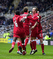Photo. Glyn Thomas.<br /> Newcastle United v Middlesbrough. Premiership.<br /> St James' Park, Newcastle. 21/02/2004.<br /> Boro's Bolo Zenden is delighted with his first half goal as he is mobbed by teammates.