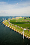 Nederland, Flevoland, IJsselmeerdijk, 14-07-2008; windmolens, onderdeel van het windmolenpark (of windpark) in het water van het IJsselmeer, omgeving van de Flevocentrale; in de achtergrond de A6; turbine, wiek windturbine, windmolen, groene energie.Windpark for green power / green nergy in the new IJsselmeer polder Flevoland . .luchtfoto (toeslag); aerial photo (additional fee required); .foto Siebe Swart / photo Siebe Swart