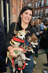 VISCOUNTESS HAWKESBURY and her dogs Salvatore & Vincent at A Date With Your Dog At George in aid of the Dogs Trust held at George, 87-88 Mount Street, London on 9th September 2014.
