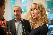 DAN TOPOLSKI; BASIA BRIGGS,  Party given by Basia and Richard Briggs at their home in Chelsea. London. 27 April 2011. <br /> <br />  , -DO NOT ARCHIVE-© Copyright Photograph by Dafydd Jones. 248 Clapham Rd. London SW9 0PZ. Tel 0207 820 0771. www.dafjones.com.