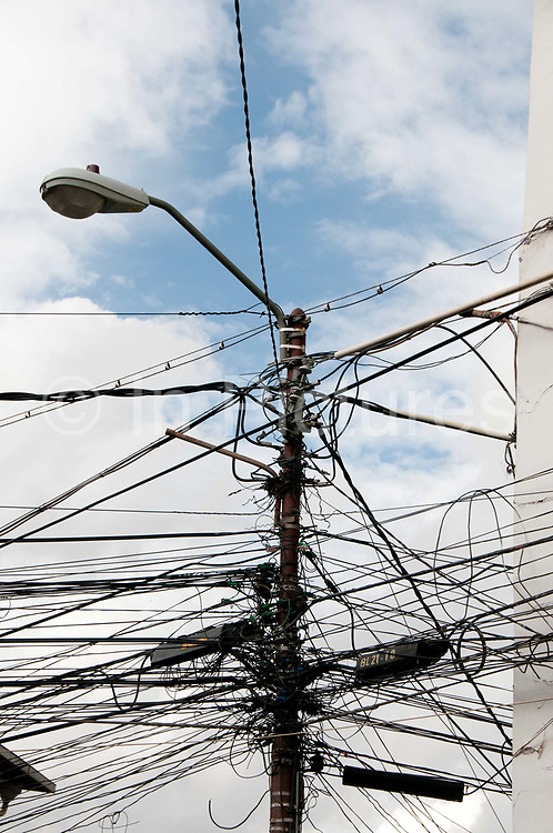 Bolivia June 2013. La Paz. Electricity wires and street light.