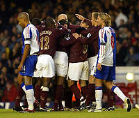 Photo: Chris Ratcliffe.<br />Arsenal v Blackburn Rovers. The Barclays Premiership.<br />26/11/2005.<br />Arsenal players celebrate Thierry Henry's goal as Steven Reid left and Robbie Savage are gutted