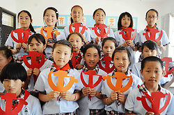 June 2, 2017 - Ma'Anshan, Ma'anshan, China - Ma'anshan, CHINA-June 2 2017: (EDITORIAL USE ONLY. CHINA OUT) Students make paper-cuttings of  emblem of Communist Party of China in Ma'anshan, east China's Anhui Province, June 2nd, 2017. (Credit Image: © SIPA Asia via ZUMA Wire)