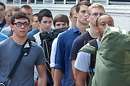 West Point, New York - Cadet candidates line up before getting on a bus at the United States Military Academy at West Point during Reception Day on July 2, 2014.