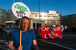 London, March 7th 2015. Following the Climate march through London, masked anarchists and environmental activists clash with police following a breakaway protest at Shell House. PICTURED: Protesters block Westminster Bridge .