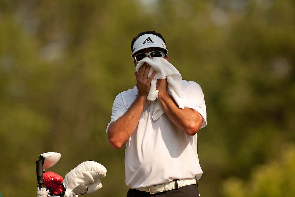 BETHESDA, MD - JUNE 30: Pat Perez towels off during the third round of the 2012 AT&T National at Congressional Country Club in in Bethesda, Maryland on June 30, 2012. (Photograph ©2012 Darren Carroll) *** Local Caption *** Pat Perez
