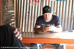 Jonathan Pite during a chai stop on day-4 our our Himalayan Heroes adventure riding from Pokhara to Kalopani, Nepal. Friday, November 9, 2018. Photography ©2018 Michael Lichter.