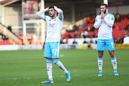 Tarryn Allarakhia puts his hands on his head during the EFL Sky Bet League 2 match between Walsall and Crawley Town at the Banks's Stadium, Walsall, England on 18 January 2020.