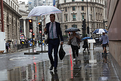 © Licensed to London News Pictures. 05/09/2016. LONDON, UK.  Commuters make their way to work near Bank during heavy rain showers and wet weather this morning.  Photo credit: Vickie Flores/LNP