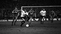 Action from the match the Derby v Liverpool. Liverpool's Steve McMahon (r)
