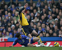 Photo: Lee Earle.<br /> Chelsea v Wigan Athletic. The Barclays Premiership.<br /> 10/12/2005. Chelsea's Joe Cole slides in on Stephane Henchoz.