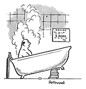 (A man has his bathtub tilted up at the end to get the best of the regulation 5 inches of water)