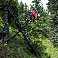 Joey Reinhart riding on T-Dub at Moose Mountain in Alberta, Canada