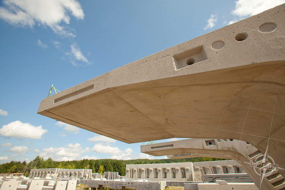 Preformed concrete walls and supports for building and highway projects.