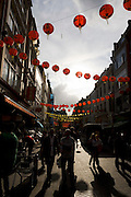 A zigzag of Chinese Moon Festival lanterns hang above Gerrard Street in London's Chinatown.